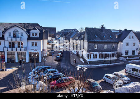 WINTERBERG, GERMANY - FEBRUARY 14, 2017: Typical slate decorated houses in the streets of Winterberg in Sauerland - Stock Photo