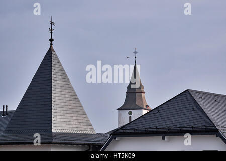 WINTERBERG, GERMANY - FEBRUARY 16, 2017: Roof of a church tower and surrounding buildings in Winterberg - Stock Photo