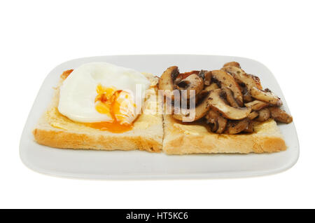 Poached egg and fried sliced mushrooms with buttered toast on a plate isolated against white - Stock Photo