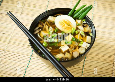 Miso soup in black bowl - Stock Photo