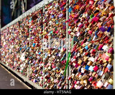 The iconic 'Love Lock' bridge of Cologne, Germany shimmers in the morning sun. - Stock Photo