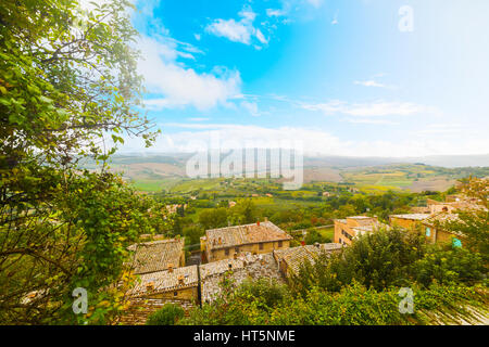 Blue sky over old roofs in Tuscany, Italy - Stock Photo