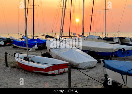 Sunset on the sea romantic view from the sand beach sailing club marina - Vada, Livorno, Tuscany, Italy, Europe - Stock Photo