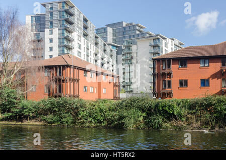 City centre apartment blocks viewed from the canal in Birmingham City Centre - Stock Photo