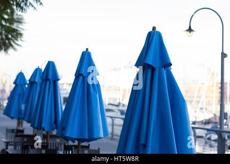 Blue umbrellas outdoor in Puerto Madero, Buenos Aires, Argentina. - Stock Photo