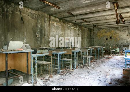 Abandoned Building Interior in school in Prypiat town in Chernobyl Zone. Chornobyl Disaster - Stock Photo
