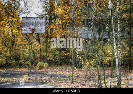 Chernobyl, Pripyat – abandoned building taken over by vegetation after nuclear disaster - Stock Photo