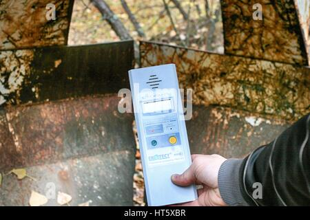 Dosimeter showing high radioactivity in Chernobyl exclusion zone - Stock Photo