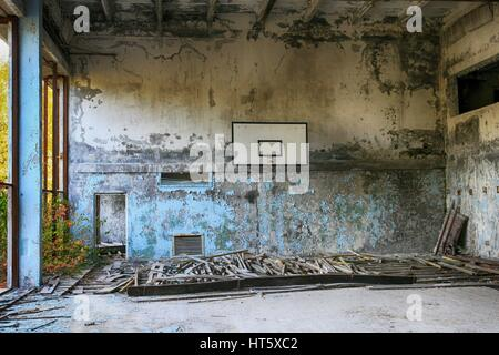 Abandoned Building Interior in school in Prypiat town in Chernobyl Zone. Chornobyl Disaster - sports hall - Stock Photo