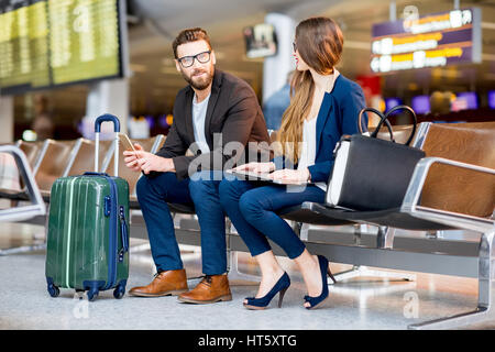 Business couple at the airport - Stock Photo