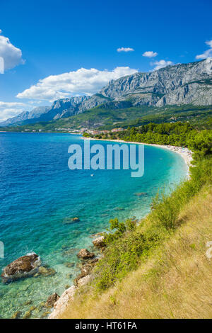 Adriatic Sea Croatia Europe. Colorful sunny summer day with blue sky and beautiful ocean. Mountains, clouds, rocks - Stock Photo