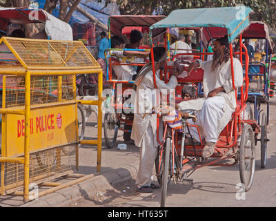 Owners of cycle rickshaws awaiting customers in the Chandni Chowk area of old Delhi, India - Stock Photo