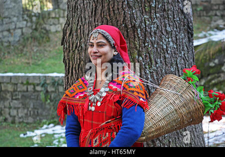 Adult woman dressed in the traditional tribal attire, pattoo, of Kullu valley in the Himalayan mountain ranges of - Stock Photo
