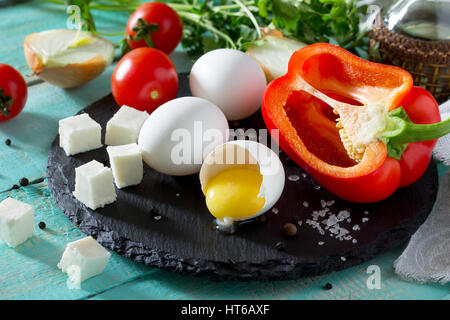 Fresh organic ingredients for the preparation of egg omelet stuffed with tomatoes and suluguni cheese. Concept of - Stock Photo