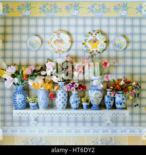 Collection of vases and flowers.