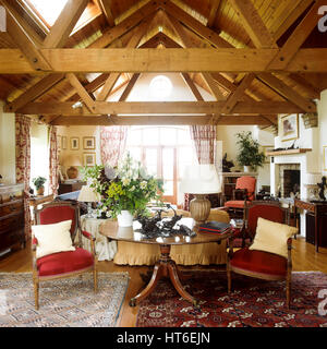 Living room with a beamed ceiling. - Stock Photo