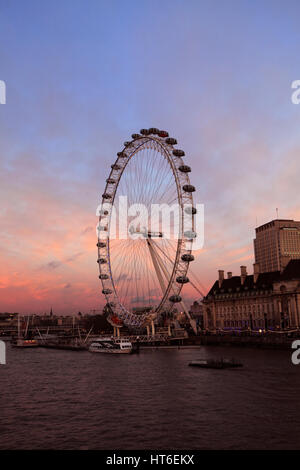 Summer sunset, London Eye or Millennium Observation Wheel opened in 1999, South Bank, river Thames, Lambeth, London - Stock Photo
