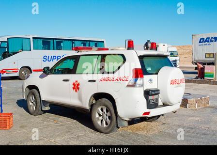 SUV ambulance, Petrom Sahara service station, N1 road, between Boujdour and Dakhla, Western Sahara, administered - Stock Photo