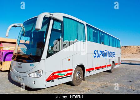 Supratousr bus, Petrom Sahara service station, N1 road, between Boujdour and Dakhla, Western Sahara, administered - Stock Photo