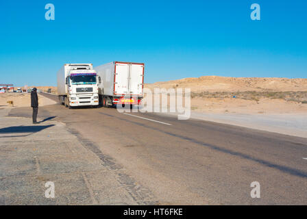 Trucks, N1 road, between Boujdour and Dakhla, Western Sahara, administered by Morocco, Africa - Stock Photo