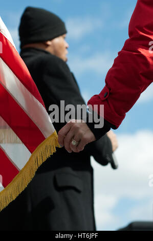 At the start of a pro-trump rally as the National Anthem is performed MC Erin Elmore holds a tip of the American - Stock Photo