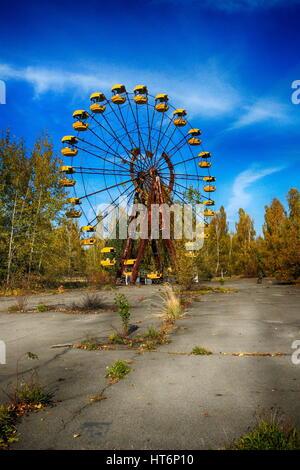 Abandoned amusement park in the Pripyat city, the Chernobyl disaster, the exclusion zone, a ghost town - Stock Photo