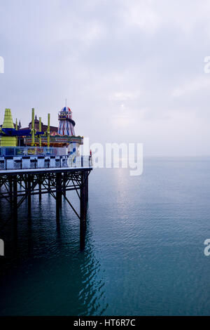 The end of brighton pier with helter scelter and other fair ground rides on the right hand side of the image, the - Stock Photo