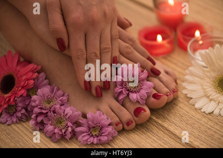 Closeup photo of a female feet and hands at spa salon on pedicure ...