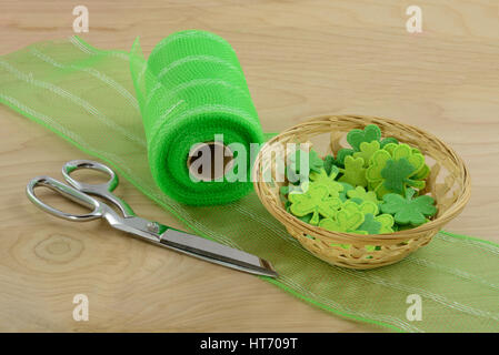 Crafting Project for Saint Patrick's Day with green ribbon and shamrocks - Stock Photo