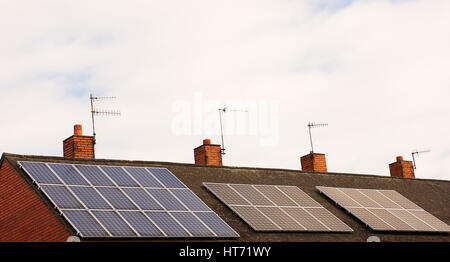 Solar panels on roof top,cloudy sky ,source of renewable energy,Stoke on Trent,Staffordshire,United Kingdom. - Stock Photo