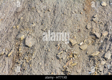 full frame shot of a hill slope with lots of stones and pebbles - Stock Photo
