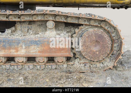 muddy crawler chain detail in earthy ambiance - Stock Photo
