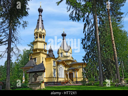 The Church of the Holy apostles Peter and Paul in the village of Vyritsa in the Leningrad region in the summer on - Stock Photo