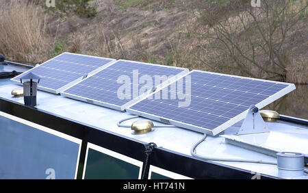 Solar panels installed on longboat roof as energy source .Stoke on Trent,Staffordshire,United Kingdom. - Stock Photo
