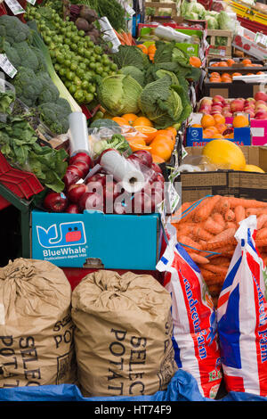 Traditional fresh fruit and vegetables pavement display outside a British green grocers shop - Stock Photo