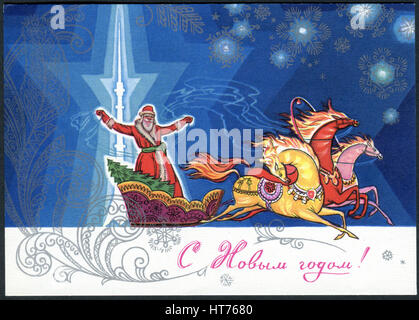 A greeting postcard printed in Soviet Union, shows Father Frost goes on a sleigh drawn by three horses. The inscription - Stock Photo