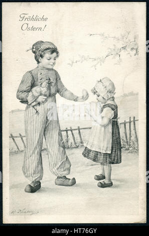 A postcard printed in Austria, shows a boy with a chicken egg on hands gives the girl. The inscription in German: - Stock Photo