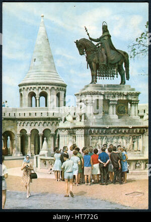 A postcard printed in Hungary, shows a view on the Fisherman's Bastion and St.Stephen Statue by sculptor Alajas - Stock Photo