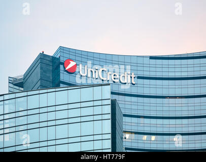 Unicredit bank skyscraper detail at dusk. Unicredit S.p.A. is one of the biggest Italian and European credit group - Stock Photo