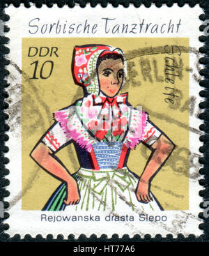 GERMANY - CIRCA 1971: A stamp printed in Germany (GDR), shows the Sorbian Dance Costumes from Schleife, circa 1971 - Stock Photo