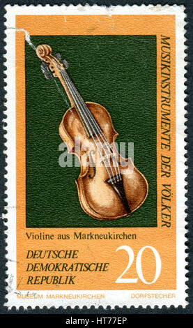GERMANY - CIRCA 1971: A stamp printed in Germany (GDR), shows the musical instrument from Germany, Violin, circa - Stock Photo