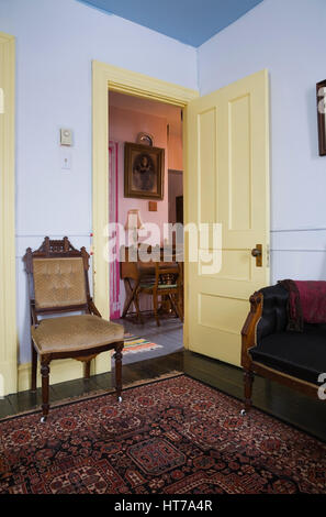 Bedroom with Eastlake chairs in 1904 Victorian old house interior. - Stock Photo