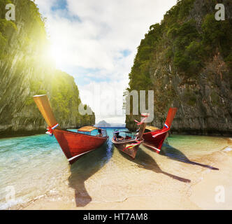Boats on the beach inside small laguna - Stock Photo