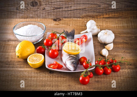 Uncooked sea bass. - Stock Photo