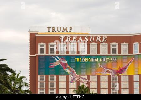 Las Vegas, USA - October 28, 2016:  Trump International hotel marquee positioned behind the Treasure Island hotel - Stock Photo