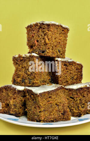 Home made carrot cake piled on plate - Stock Photo
