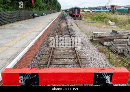 End of the line. Buffers and railway track at Ruddington Fields station, Nottingham Transport Heritage Centre, England, - Stock Photo