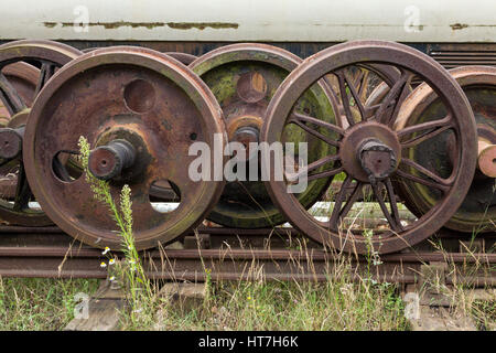 Old rusty railway wheels for a train carriage or locomotive, Ruddington, Nottinghamshire, England, UK - Stock Photo