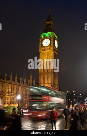 A Double Decker Bus Drives Over The Westminster Bridge In London, England - Stock Photo
