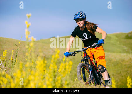 A Woman Biking On The Bonneville Shoreline Trail - Stock Photo